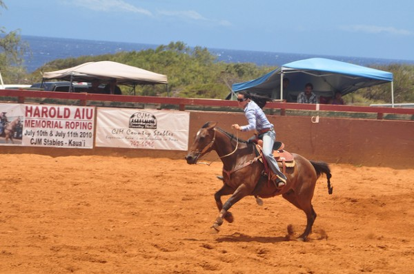 brunette woman racing horse barrel race rodeo kauai