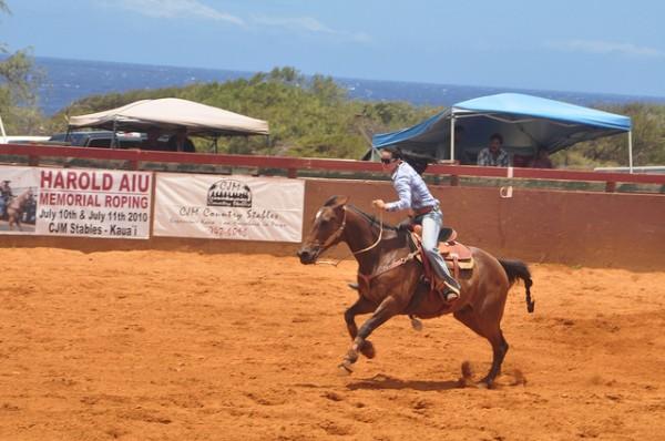 brunette woman racing horse barrel race rodeo kauai