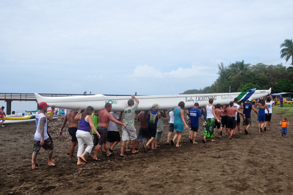 Winning Team Carries Canoe From Beach - Photo by Ray Gordon