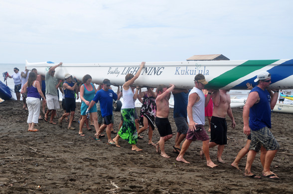 Team Carrying Canoe From Beach - Photo by Ray Gordon