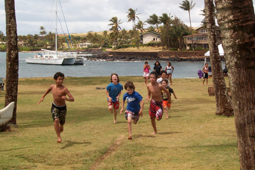 Hawaiian Children Running Keiki Canoe Paddling Program