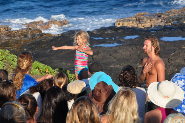 Child singing hula at celebration of the whales