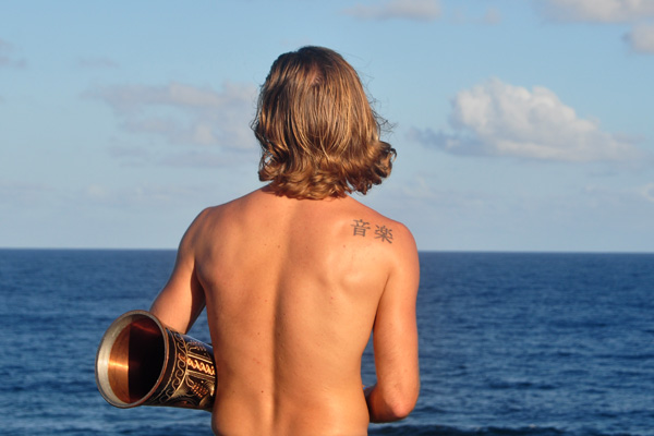 Elijah Ray with Drum Shot of His Back Kauai by Ray Gordon