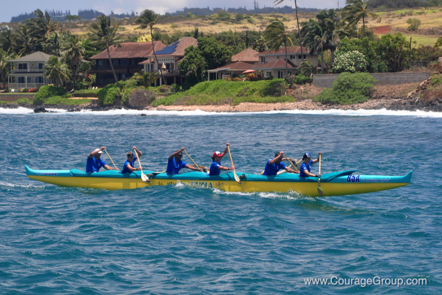Kaiola Mixed OC6 winner of Mixed Open Division arriving at harbor Paddle Fest Kauai - Photo by Ray Gordon