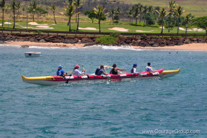 Na Molokama women winner of Wahine OC6 gliding into the harbor Kauai Paddle Fest