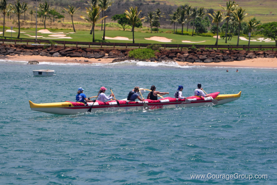 Na Molokama women winner of Wahine OC-6 gliding into the harbor Kauai Paddle Fest