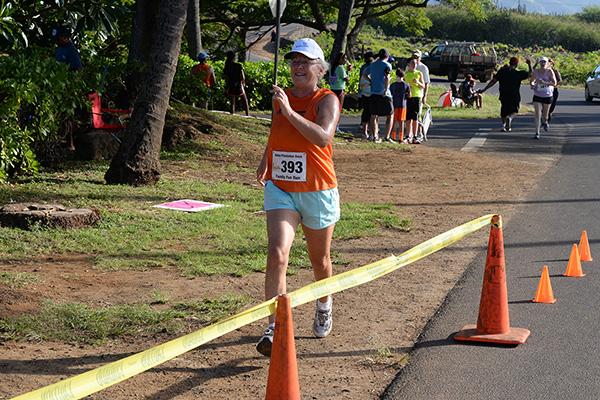 Linda Sherman finishing 5K photo by Ray Gordon Family Fun Run Koloa Plantation Days