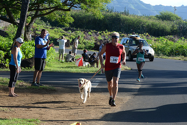 Tom Biehn first in his 5K category with dog Koko photo by Ray Gordon Family Fun Run Koloa Plantation Days