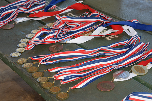 Medals photo by Ray Gordon Family Fun Run Koloa Plantation Days