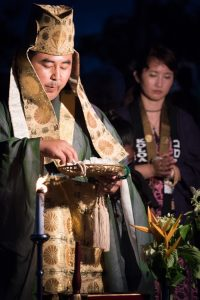 Rev. Ishikawa blessing ceremony before the Toro Nagashi lanterns are put to sea. Wife Yayoi by his side. Photo by Nani McMahon.