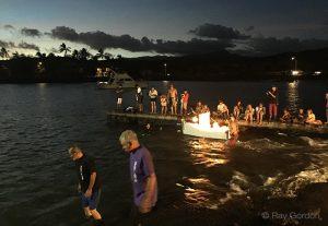 Putting the lead boat for the toro nagashi Kauai into the water