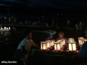 Volunteers getting the first raft of lanterns onto the water. Photo by Ray Gordon